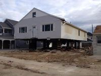 Ortley Beach, NJ – a house pushed into the neighbor's house, moved back into it's lot.