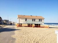 Manasquan, NJ House moved over boardwalk back to lot.