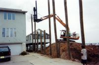 Pile driving a New Jersey shore dwelling utilizing a diesel hammer. This method allows us to get piles driven in tight work spaces.