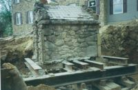Historic well house moved to make way for new homes.